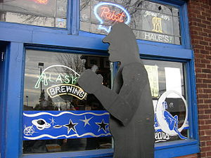 """Blue Moon Tavern - """"Hammered Man"""" sculpture in front of the Blue Moon, a parody of """"Hammering Man""""."""