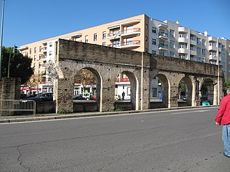 Caños de Carmona - The final section of the Caños de Carmona aqueduct which survived demolition by being incorporated into the pillars of the Puente de la Calzada, located in the middle of the road near the start of Calle Luis Montoto.