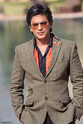 Shah Rukh Khan posing outside at a film festival