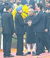 Shinzo Abe and the President, Shri Pranab Mukherjee being received by the Prime Minister, Dr. Manmohan Singh, on their arrival at the 65th Republic Day celebrations, in New Delhi on January 26, 2014.jpg