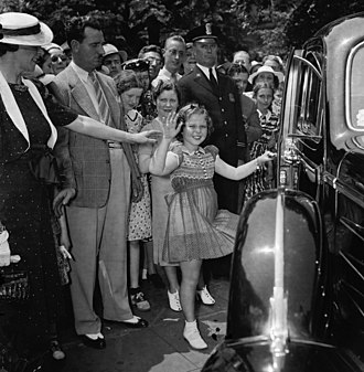 Shirley Temple - Shirley Temple leaving the White House offices with her mother and her bodyguard, John Griffith, 1938