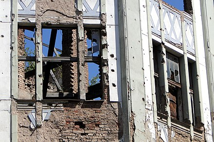 War damage on a Sarajevo building Siege-Shattered Facade - Sarajevo - Bosnia and Herzegovina.jpg