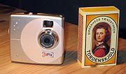 A SiPix digital camera next to a matchbox to show scale