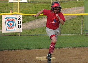 Softball Player Rounding Bases