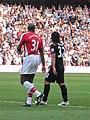 Sol Campbell Carlos Tevez Arsenal vs. Man City @ Emirates.jpg