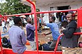 Some guys having a dance-off while unloading their cargo from a truck on the market in Chimoio.jpg