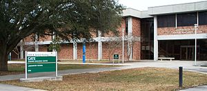 Charles Emery Cate - Charles Emery Cate Teacher Education Center at Southeastern Louisiana University, viewed from North General Pershing Street. Shown is a section of the west side of the building. The University's Laboratory School (K-8) is at the left.