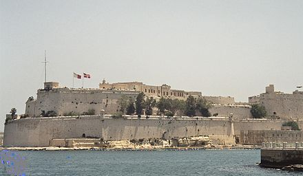 View from Valletta, Malta, showing Fort Saint Angelo, belonging to the Sovereign Military Order of Malta. St. Angelo.jpg