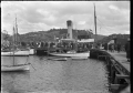 "Stewart Island. The SS ""Theresa Ward"" at a wharf on Stewart Island, partially obscured by a crowd of people. ATLIB 273989.png"