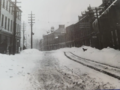 Streetcars tracks in St. John's on a snowy day.webp