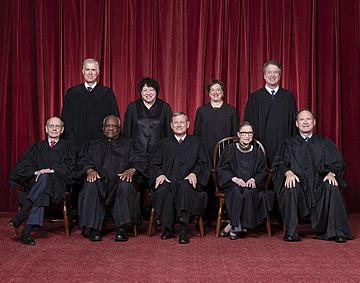 The Roberts Court justices (October 6, 2018 to September 18, 2020): Front row (left to right): Stephen Breyer, Clarence Thomas, Chief Justice John Roberts, Ruth Bader Ginsburg (since deceased), and Samuel Alito. Back row (left to right): Neil Gorsuch, Sonia Sotomayor, Elena Kagan, and Brett Kavanaugh. Supreme Court of the United States - Roberts Court 2018.jpg
