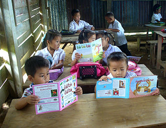 Sustained silent reading - Children in a Lao primary school on their first day of a Sustained Silent Reading (SSR) program. This village, in Kasi district of Laos, was the site of the first SSR program in Laos. It was set up by Big Brother Mouse, which publishes and distributes books to promote reading and literacy, with an emphasis on easy and fun books that children are eager to read.