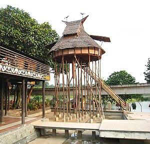 Stilts (architecture) - A Dayak Rumah Baluk with 5-meter-tall stilts, West Kalimantan pavilion TMII.