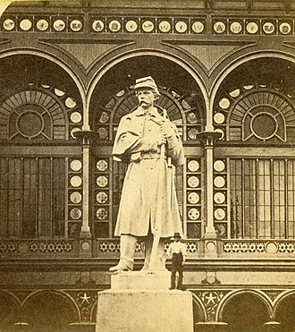 The American Volunteer (statue) - The American Volunteer, at the 1876 Centennial Exposition. Note the man standing beside it.