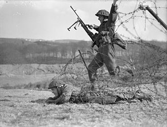 British Commandos - Commandos demonstrate a technique for crossing barbed wire during training in Scotland, 28 February 1942.