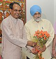 The Chief Minister of Madhya Pradesh, Shri Shivraj Singh Chauhan meeting the Deputy Chairman, Planning Commission, Shri Montek Singh Ahluwalia for finalizing plan size for 2013-14 for the State, in New Delhi on May 22, 2013.jpg