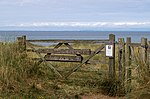 The Lhen Nature Reserve. Isle of Man. Shown is the entrance to the Cronk y Bing nature reserve at the Lhen Beach.