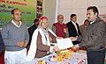 The Mayor Jhansi, Dr. B. Lal presenting certificate at the Public Information Campaign on Bharat Nirman oraganised at Baruasagar, Jhansi on January 09, 2011.jpg