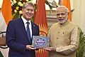 The Prime Minister, Shri Narendra Modi presents the President of the Republic of Kyrgyzstan, Mr. Almazbek Sharshenovich Atambayev with a Kyrgyz translation of Indian poems, at Hyderabad House, in New Delhi.jpg