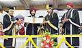 The Vice President, Shri M. Venkaiah Naidu presenting the Punjab University Khel Rattan Award to Padma Shree Milkha Singh, at the 67th Convocation of Panjab University, in Chandigarh on March 04, 2018.jpg