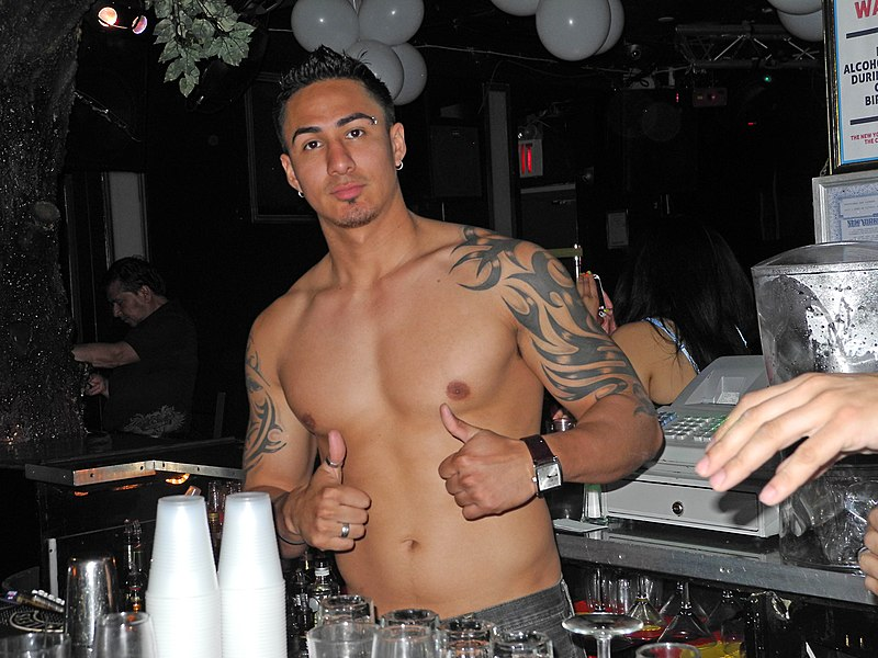 File:Topless bartender at Club Evolution in New York City.jpg