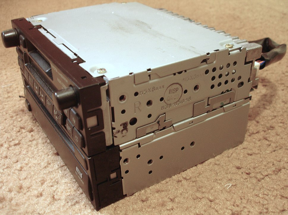 Toyota factory head unit and compact disc player with ISO 7736 dashboard bracket screw holes.jpeg