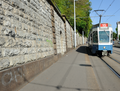 Tram approaches Stadelhofen station in Zurich Switzerland.png