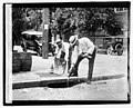 Two men pouring liquor into storm drain), 7-8-21 LOC npcc.04520.jpg