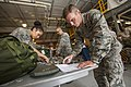 U.S. Air Force Staff Sgt. Esmeralda Ayala, left, and Airman 1st Class Brandon King, both with the 108th Wing, New Jersey Air National Guard, perform an inventory of King's equipment May 22, 2013, at Joint Base 130522-Z-AL508-020.jpg