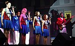 U.S. Air Force Tops in Blue members performing on stage at Aviano AB, Italy 041023-F-RO738-003.jpg