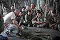 U.S. Army Sgt. 1st Class Garrett Williams explains how to adjust and don a T10D parachute prior to a training jump with Indian paratroopers.jpg