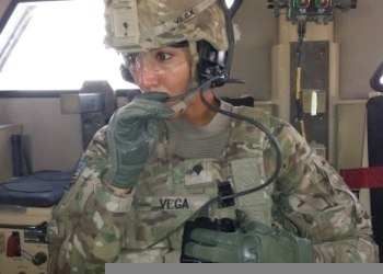 U.S. Army Spc. Nancy Vega, a truck driver with Echo Company, 2nd Battalion, 2nd Infantry Regiment, 3rd Infantry Brigade Combat Team, conducts a radio check before a mission brief at Forward Operating Base 130807-A-ZZ999-002