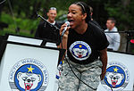 U.S. Army Staff Sgt. Chrystal Downs, with the 9th Army Band, 2nd Engineer Brigade, sings as she performs during the brigade's special event, called Arctic Trailblazer Week, at Cottonwood Park on Joint Base 120810-F-LX370-868.jpg