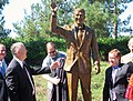 U.S. Congressman Dana Rohrabacher, President Ronald Reagan's speechwriter, and Congressman Ed Royce with Statue of Reagan in Newport Beach, CA in 2011.jpg