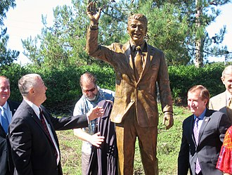 Dana Rohrabacher - Rohrabacher and Ed Royce with Statue of President Ronald Reagan in Newport Beach, California in 2011