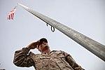 U.S. Marines raise the American flag over Camp Leatherneck 130615-M-YH552-012.jpg