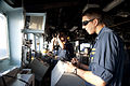 U.S. Navy Ensign Allen Worcester, left, and Lt. j.g. Jordan Klein stand watch on the bridge of the guided missile cruiser USS Gettysburg (CG 64) during a straits transit in the Gulf of Oman Dec. 15, 2013 131215-N-PL185-154.jpg