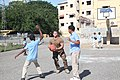 U.S. Navy Equipment Operator Constructionman Justin Holden plays basketball with a Dominican boy during recess at Escuela Basica Rafaela Santaella in Santo Domingo, Dominican Republic, during High Speed Vessel 111116-A-IP644-078.jpg