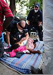 U.S. Navy and Coast Guard medics treat an earthquake victim at the Haitian Coast Guard base Amiral Killick in Carrefour, Haiti, Jan. 16, 2010 100116-N-KG216-264.jpg
