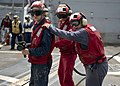 U.S. Sailors simulate putting out a fire during a crash and salvage drill aboard the guided missile destroyer USS William P. Lawrence (DDG 110) Aug. 30, 2013, in the Arabian Sea 130830-N-ZQ631-028.jpg