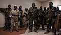 U.S. Sailors with Naval Mobile Construction Battalion (NMCB) 25 receive instructions after donning mission-oriented protective posture gear during a simulated chemical attack during chemical, biological 140214-N-JP566-058.jpg
