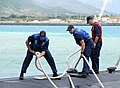U.S Sailors assigned to the attack submarine USS Chicago (SSN 721) secure mooring lines as the Chicago returns to Apra Harbor, Guam, April 25, 2013 after completing its first mission as part of Commander 130425-N-LS794-182.jpg