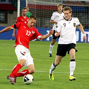 André Schürrle - Schürrle playing for Germany in a UEFA Euro 2012 qualifier against Austria, on 3 June 2011