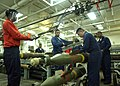 US Navy 020807-N-2147L-001 Sailors aboard CVN 73 dismantal a MK-82 bomb in one of the ship's magazines.jpg