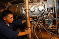 US Navy 021022-N-5471P-070 Gas Turbine Systems Technician Second Class Sherwin Corpuz inspects a K-17 Gas Turbine Generator.jpg