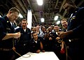 US Navy 030329-N-4048T-088 Chief Boatswain's Mates Kelvin Dickey (left) and Chief Petty Officer George Gainey square off in a knot-tying contest.jpg