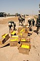 US Navy 030405-A-0000F-003 Paratroopers assigned to the 82nd Airborne Division open boxes of humanitarian rations for distribution to Iraqi citizens in central Iraq.jpg