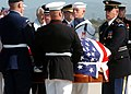 US Navy 040609-N-9712C-002 Ceremonial Honor Guard personnel carry former President Ronald Reagan's flag-draped mahogany casket from a hearse.jpg