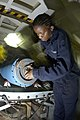 US Navy 040810-N-9458H-028 Airman Takiya Minter, from Brooklyn, N.Y., installs the safety pin into a Mark 83 general-purpose practice bomb in a weapons magazine aboard the aircraft carrier USS Kitty Hawk (CV 63).jpg