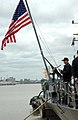US Navy 041106-F-0697K-070 The American flag is lowered aboard the guided missile frigate USS DeWert (FFG 45) as she prepares to depart the naval port in Montevideo, Uruguay.jpg
